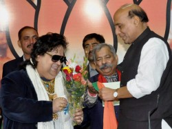 Trinamool Workers Heckle Bappi At Temple