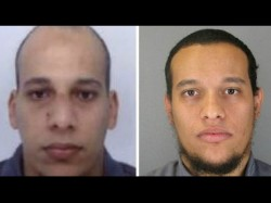 Charlie Hebdo One Gunman Surrenders To Police Another Two Still At Large