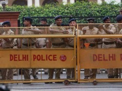 Video Delhi Police Constable Who Threw Brick Assaulted Woman Arrested
