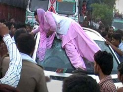 Young Agra Woman S Protest On Top Of Mercedes Goes Viral