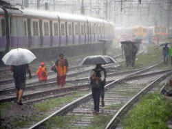 Due Haeavy Rain Train Service Disrupted At Howrah Station