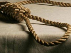 Tied Infant Son With Her Body Mother Is Hanging From The Ceiliing Fan
