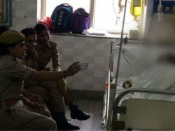 Up Women Constables Suspended After Selfies With Acid Attack Gangrape Survivor
