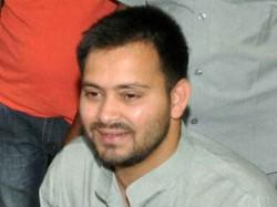 Photo War Erupts Between Rjd Jdu Tejaswi Slams Nitish