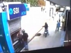 Guard Foils Sbi Atm Robbery Bid Two Men Delhi