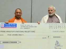 Up Cm Yogi Adityanath Hands Over Cheque Worth Rs 5 Cr Pm Modi Relief Fund Cyclone Ockhi