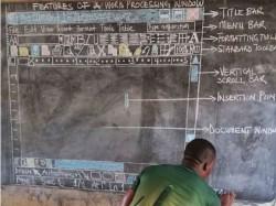 Teacher Ghana Who Used Blackboard Explain Computers Gets 5 Computers And A Laptop