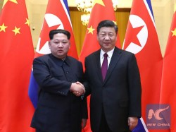 North Korea Ruler Kim Jong Un Makes First Foreign Visit China