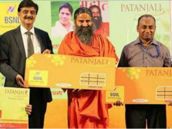 Ramdev S Patanjali Ties Up With Bsnl Launches Sim Card