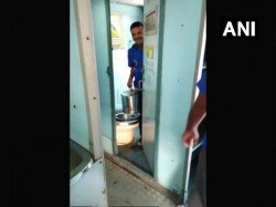 Viral Video People Were Seen Bringing Tea Coffee Cans From Inside A Train Toilet At Secunderabad