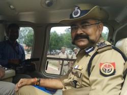 P Police Officer S Flower Shower Kanwar Pilgrims Sparks Outrage
