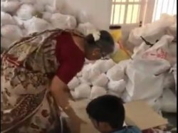 Video Infosys Co Founder Narayana Murthy Wife Sudha Murthy Packing Relief Material Flood Kerala