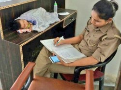 Up Woman Police Archana Jayant Takes Care Her Baby Office Pic Goes Viral