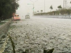 Watch Video Rain Hailstorm Hit Delhi Ncr Flight Operations Traffic Affected