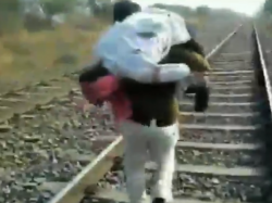 Mp Police Constable Carries Man Who Fell Off Train On Shoulder