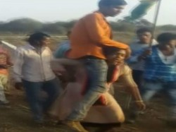 Woman Forced To Carry Husband On Shoulders As Punishment For Lov Marriage