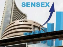 Share Market Surges About 900 Points Due To Primary Trends In Counting For The Victory Of Nda