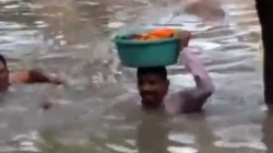 Gujrat Cops Carries Baby Girl On His Head In Neck Deep Water