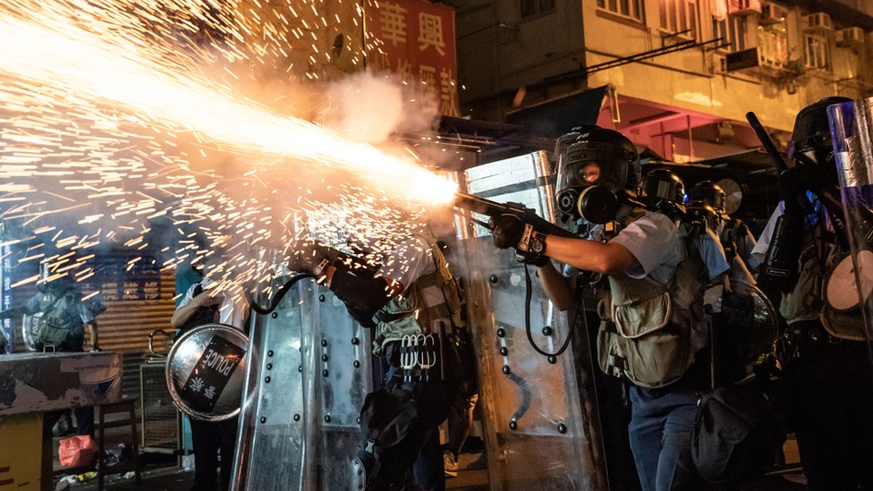 Police fire tear gas against protesters in Hong Kong on 14 August
