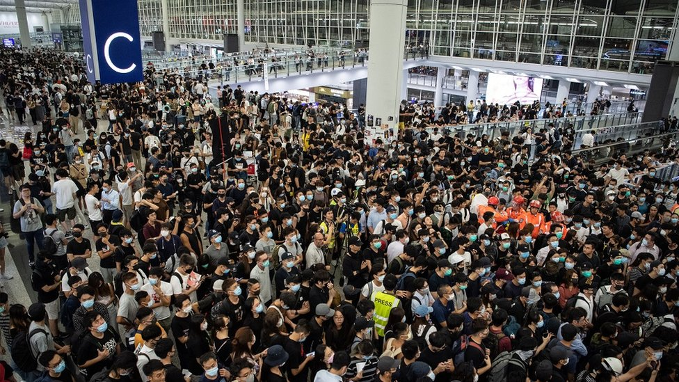 Protesters stage a sit-in at Hong Kong International Airport on 13 August 2019