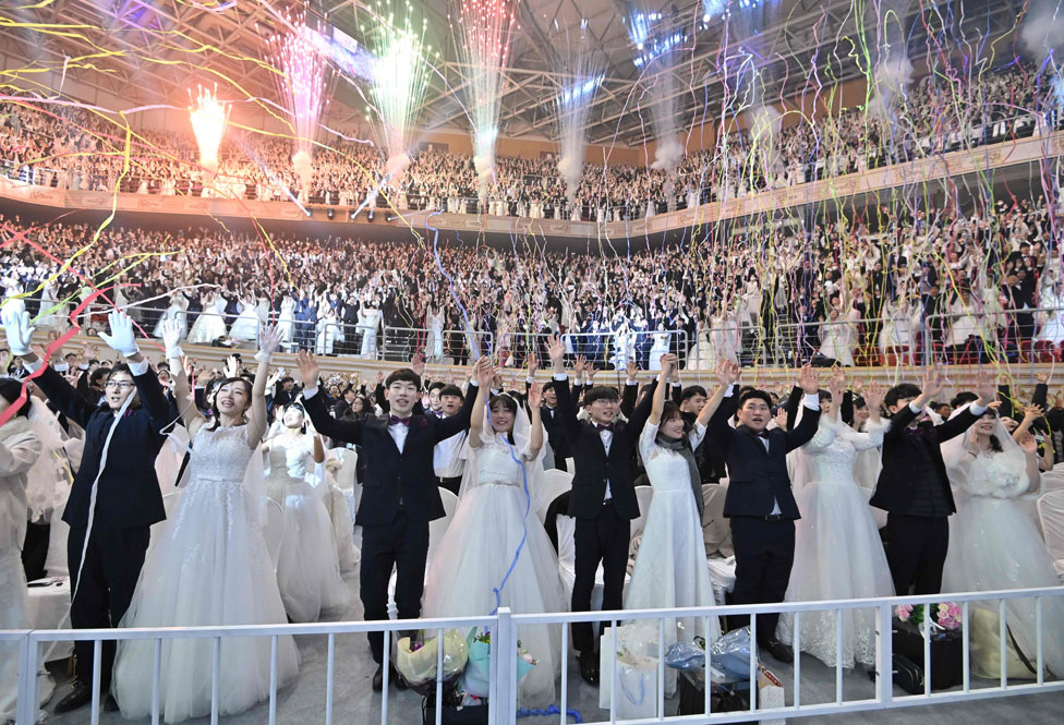 Couples celebrate at a mass wedding ceremony organised by the Unification Church in Gapyeong